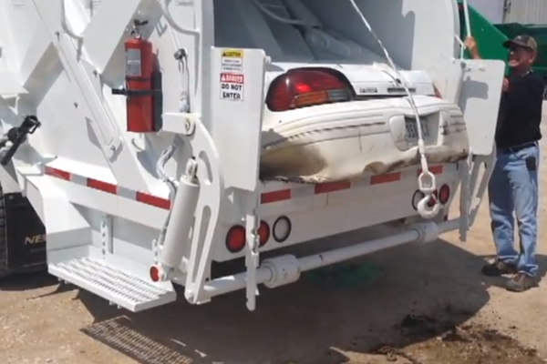 Watch A Garbage Truck Crush A Car Like Paper
