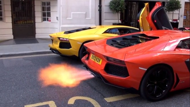 Watch Two Angry Aventadors Spit Fiery Flames On The